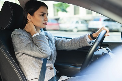Woman with pain neck due physical injuries caused by a car accident